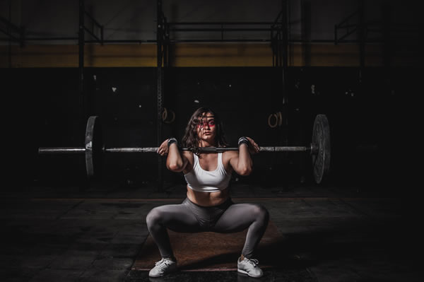 Lifting weights is great for muscle building, strength and burning fat.